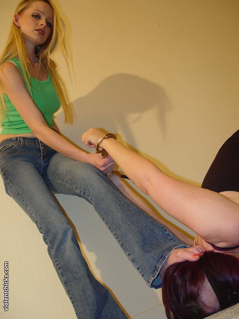 Under sexy dominant Mistress feet