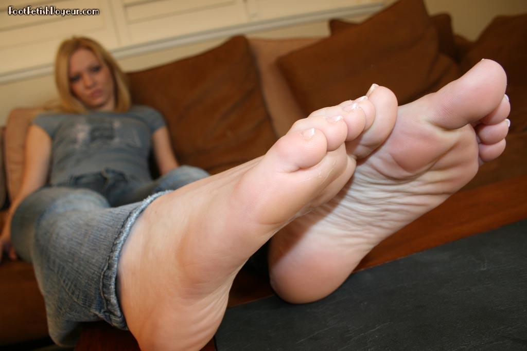 Foot slave doing his job