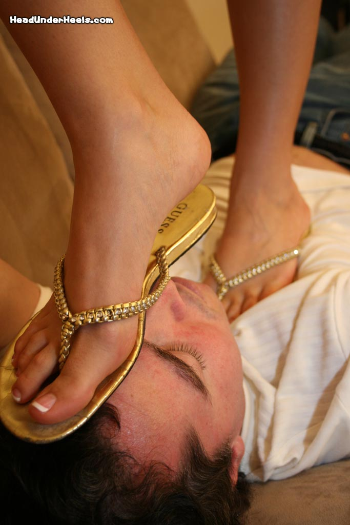 Cruel Mistress orders slave to worship her feet
