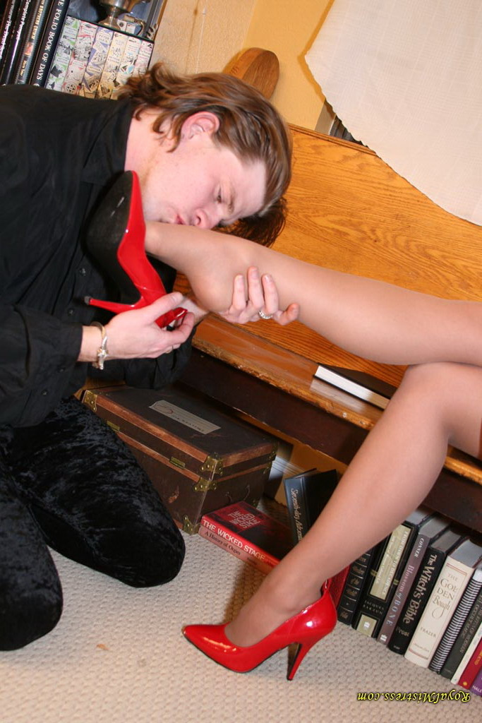Mistress is relaxing while her foot slave is doing foot worship
