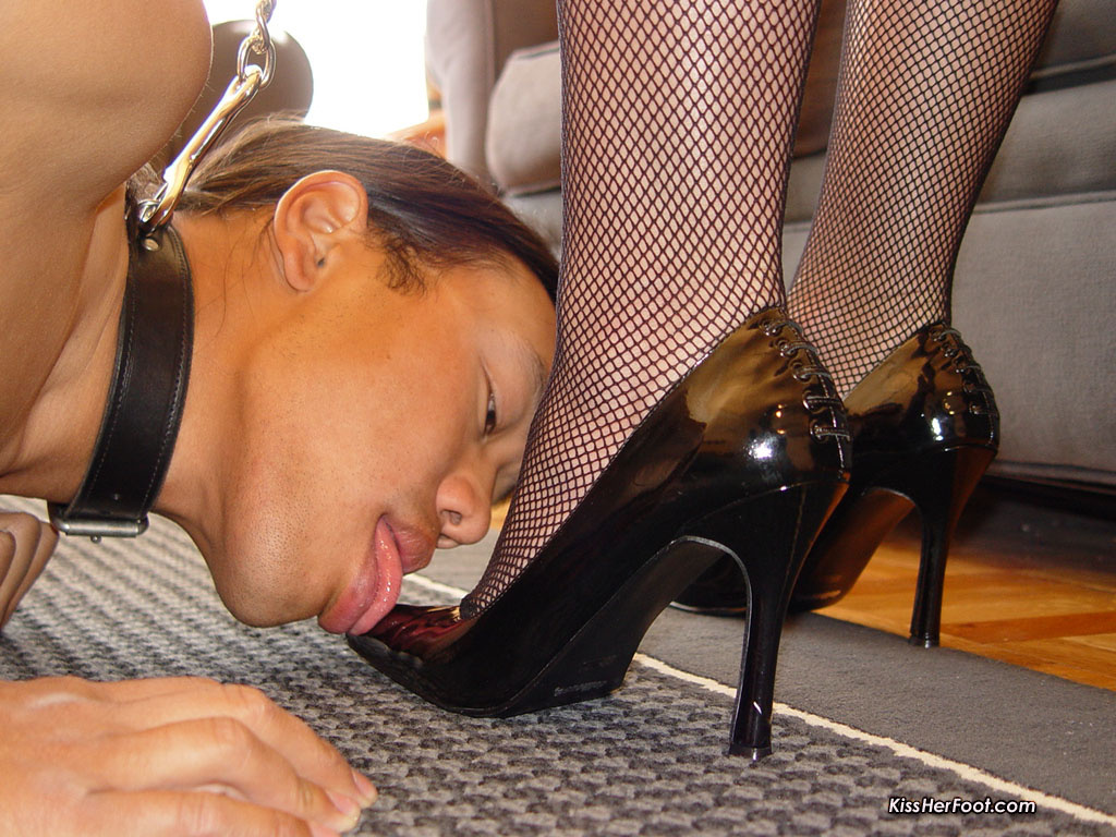 Obedient slave is worshiping the feet of his beautiful Goddess