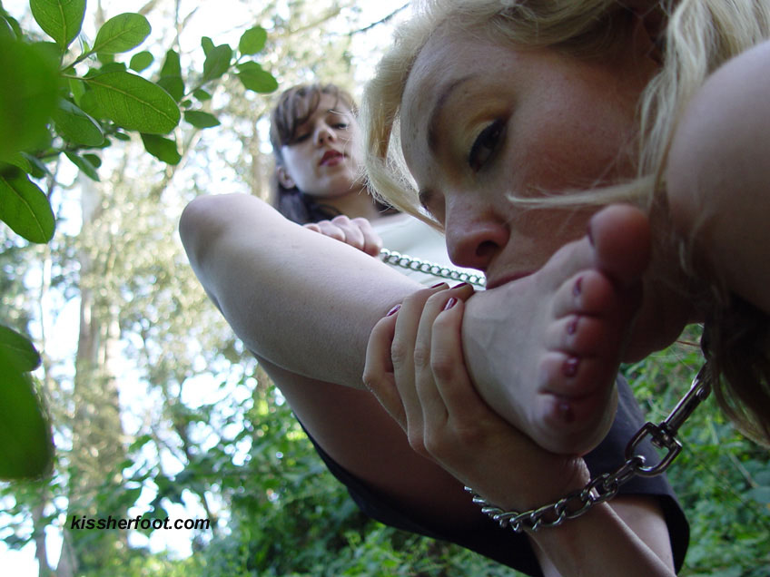 Dominatrix orders slave to worship her shoes